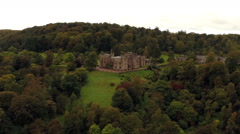 Stock Video Footage of Aerial shot of Muncaster Castle in Cumbria, England