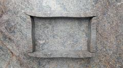 Stock Illustration of Empty frame stone shelf on stone wall.