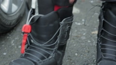 Suits snowboard boots. Close-up Stock Footage