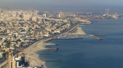 Panoramic view of Sharjah coastline from Ajman rooftop timelapse - third largest Stock Footage