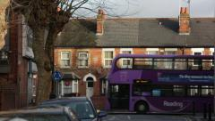 Terrace houses and a double decker Stock Footage
