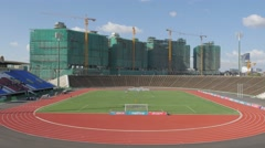 Football match in national stadium with contruction site,Phnom Penh,Cambodia Stock Footage