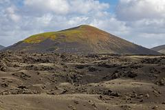 Stock Photo of Hilly volcanic landscape Montana Bermeja Los Volcanes Natural Park Lanzarote