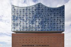 Elbe Philharmonic Hall glass facade with reflection of clouds Hamburg Germany - stock photo