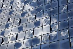 Glass facade with reflection of clouds Elbe Philharmonic Hall Hamburg Germany - stock photo