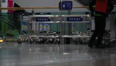 Arranging luggage carts in the airport Stock Footage