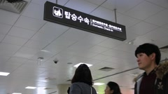 Sign board of domestic check in at Jeju island airport - stock footage