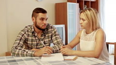 Family couple sitting at desk with documents - stock footage