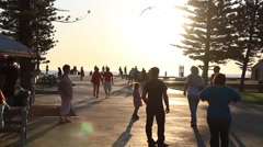 People at the sea against the sunlight - stock footage