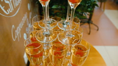 Sparkling champagne flutes on tray with cherry - stock footage
