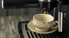 Stock Video Footage of Espresso machine pouring strong looking fresh coffee into a neat  cup