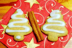 Homemade Christmas gingerbread with cinnamon on Christmas background on woode Stock Photos
