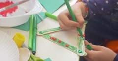 Kid is Coloring a Decorative Triangle by Green Marker Rhinrstores are on a Stock Footage