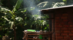 Slider shot of a traditional mud hut kitchen in rural Africa Stock Footage