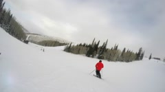 Slow motion shot of a man skiing fast down the mountain resort hill - stock footage