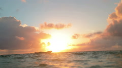 Floating in sea water at sunrise, point of view perspective Stock Footage