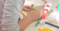 Kid's Hands Girl in Gray Blouse is Painting Coloring Decorating Triangle With Stock Footage