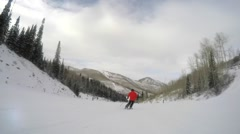 Slow motion shot of man skiing fast down the mountain resort hill - stock footage