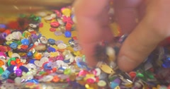 Hand Put into a Heap of Sequins Colorful Sequins Close Up Hand Touches It Stock Footage
