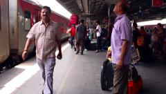 New Delhi Railway station smooth tracking shot. Porters on platform. Stock Footage