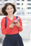 Attractive young asian student traveling outdoor smiling face with happiness Stock Photos