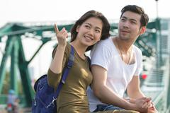couples of younger asian man and woman relaxing with happy face on vacation t - stock photo