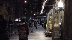 NYU students walking at night outside grocery store ATM University Place NYC 4K Stock Footage