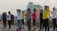 People stretching before aerobic,Phnom Penh,Cambodia - stock footage