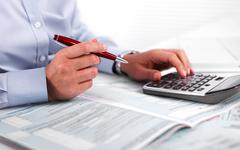 Hands of accountant business woman with calculator. Stock Photos