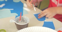 Children's Hands Kid is Making a Paper Applique Educator Helps Him Putting a Stock Footage