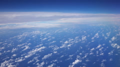 Blue sky view from aircraft airplane and white clouds over the ocean. Stock Footage