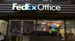 FedEx Office store sign on Union Square - exterior shot people walking 4K NYC Stock Footage