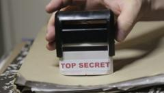 'Top Secret' stamp on a big folder of paperwork Stock Footage