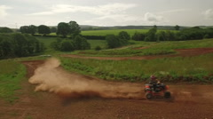 Tracking drone shot of quad bikes / off road vehicle on a dusty dirt track Stock Footage
