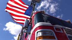 American flag waving in wind hanging from firetruck pan 4k Stock Footage