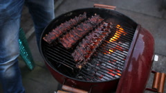 Spare ribs on barbeque grill Stock Footage