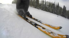 Slow motion shot of a skier skiing fast down the mountain resort hill Stock Footage