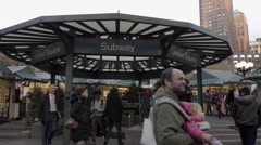 Union Square subway station hut on fall day man with baby people traveling 4K NY Stock Footage