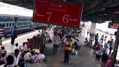New Delhi Railway station smooth tracking shot along platform as train leaves Stock Footage