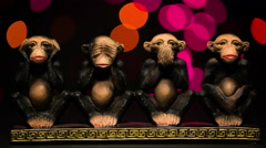Stock Video Footage of Figure four symbolic monkeys on bokeh background