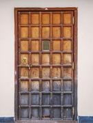 Stock Photo of ?ld wooden door with a bronze lock