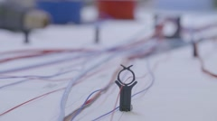 Red, blue and white electrical wires in diagram - stock footage