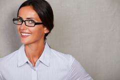 Young woman in close up head and shoulders portrait wearing glasses and forma Stock Photos