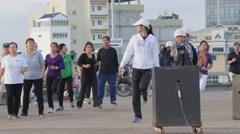 People doing aerobics at olympic stadium,Phnom Penh,Cambodia Stock Footage