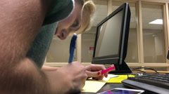 Female Teenager working on homework Stock Footage
