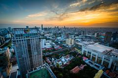View of modern skyscrapers in Siam at sunset, in Bangkok, Thailand. - stock photo