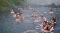 People bathe in the hot geothermal springs Stock Footage