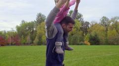 Stock Video Footage of Daughter enjoys riding dads shoulders