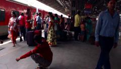 New Delhi Railway station smooth tracking shot along platform in slow motion. Stock Footage