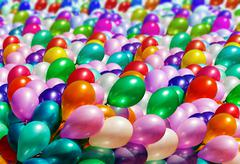 Multi-colored balloons background Stock Photos
